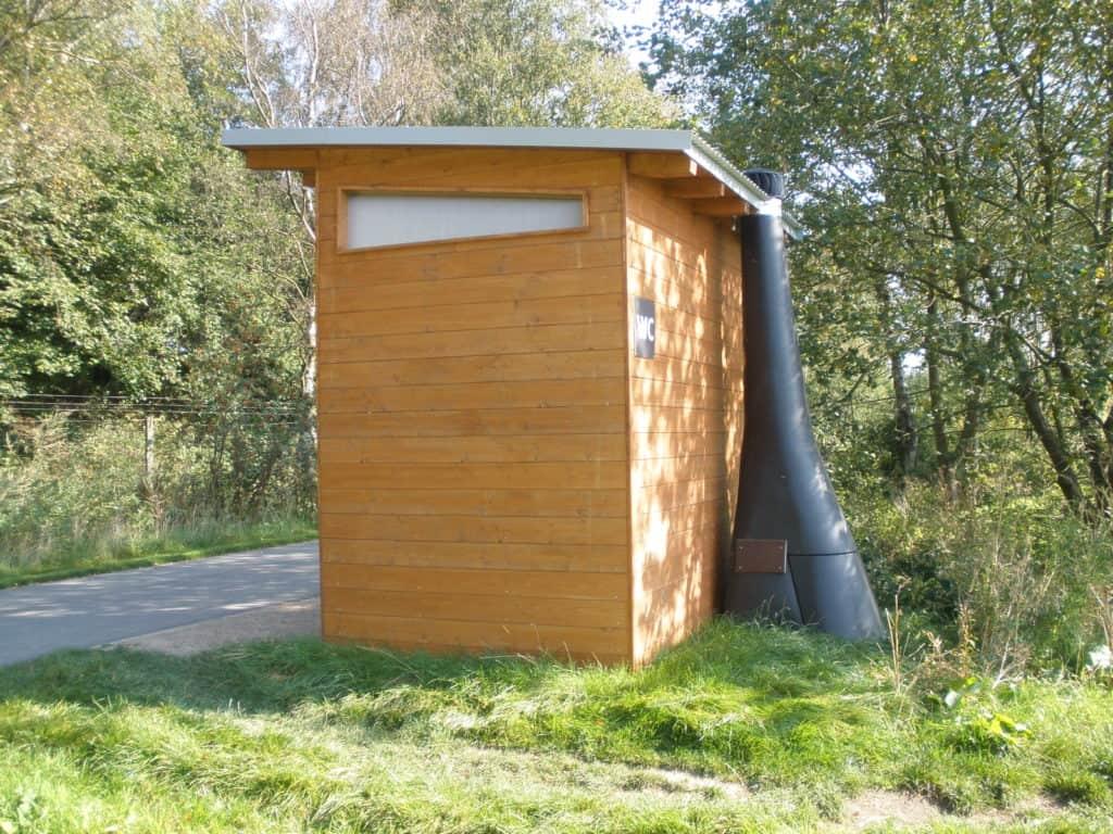 Waterless composting toilets