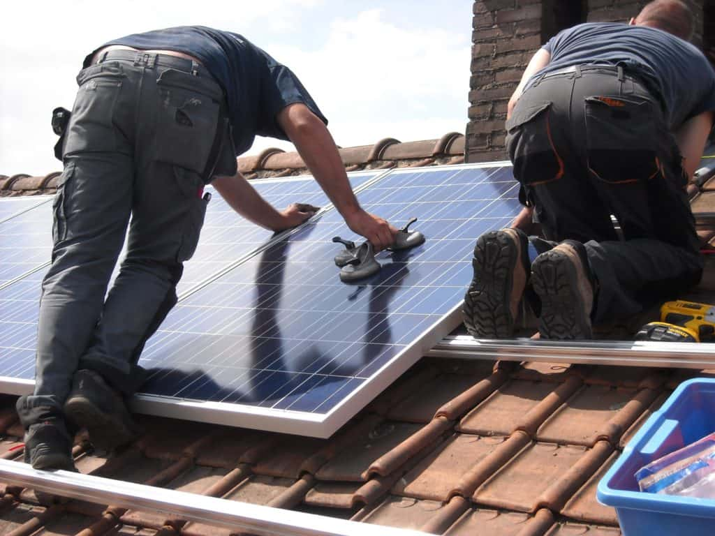 Photo of someone cleaning solar panels