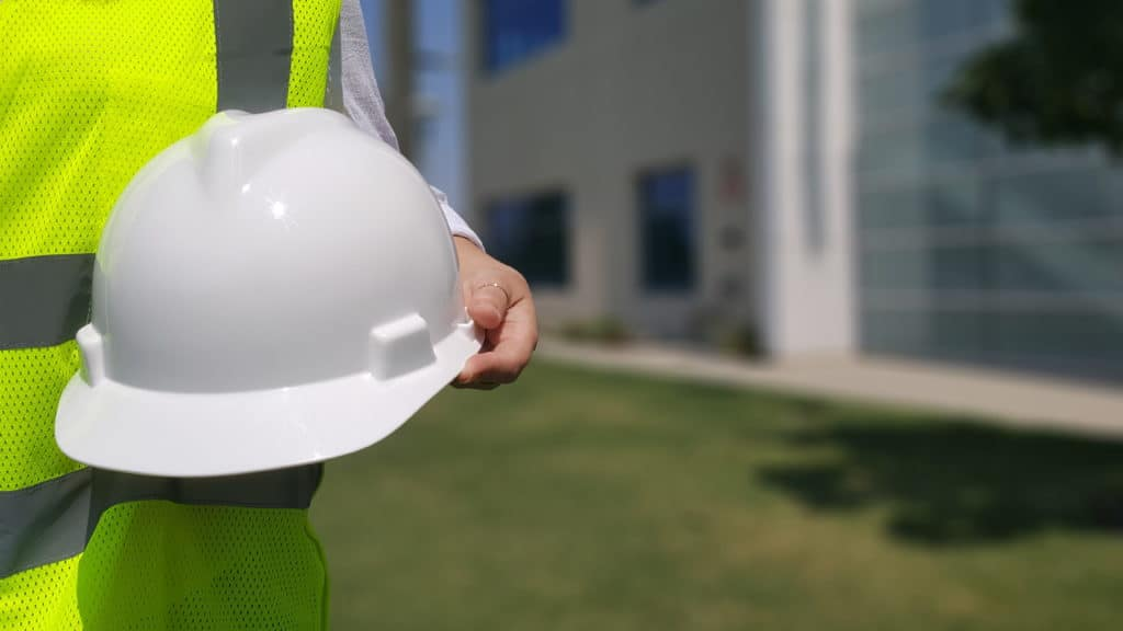photo of someone holding a safety hat