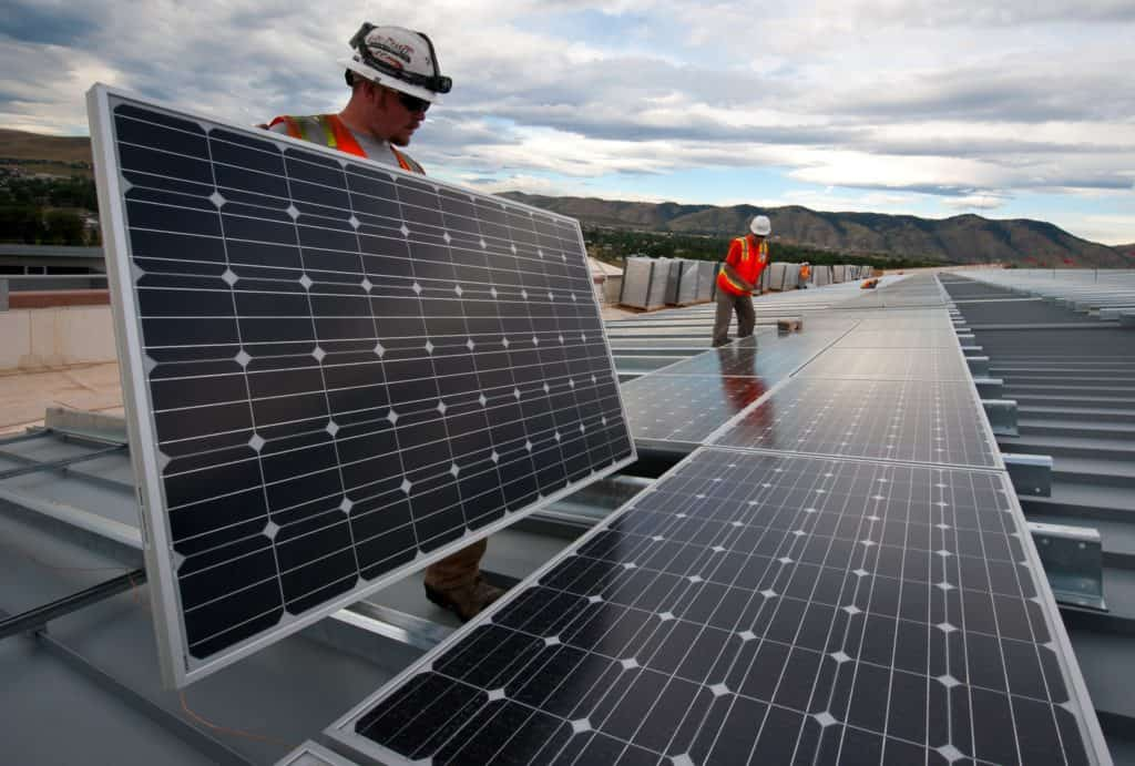 Photo of workers installing monocrystalline solar panels