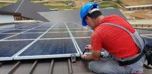 photo of a man testing the solar panel performance